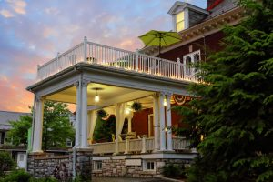 Evening exterior photo of Olde Square Inn and side veranda